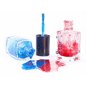 Spilled nail polish bottles and splashes — Stock Photo