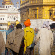 Stock Photo: Sikh pilgrims in Golden Temple