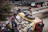 People working on garbage car — Stock Photo