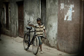 Indian small boy with bicycle — Stock Photo