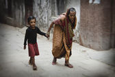 Old woman and boy in streets of Varanasi — Stock Photo