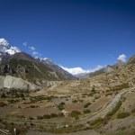 Himalayan mountains over Manang village — Stock Photo #36792769