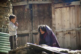Nepalese woman and boy — Stock Photo