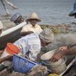 Stock Photo: Fishermens fishing in their wooden boats