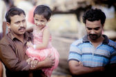 Indian men with child — Stock Photo