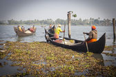 Fishermens fishing in their wooden boats — Stock Photo