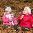 Two girl blowing bubbles outdoors — Stok fotoğraf