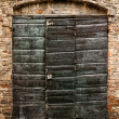 Stock Photo: The door of an ancient