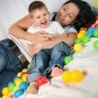 Mother playing with her son — Stock Photo #18775337