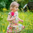 Cute little girl in the garden — Stock Photo