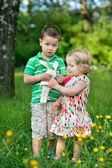 Small children in the garden — Stock Photo