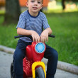 Boy on scooter — Stock Photo