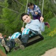 Baby boy playing on swing — Stock Photo