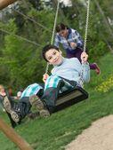 Baby boy playing on swing — Stock Photo