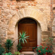 Old door in of brick building — Stock Photo