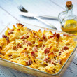 Baked pasta with smoked meat — Stock Photo
