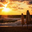 Parasols at sunset in the Mediterranean resort — Stock Photo