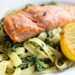 Salmon with pasta and spinach — Stock Photo