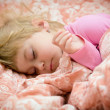 Child sleeping in bed — Stock Photo