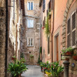 Stock Photo: Pretty street in ancient city of Tuscany