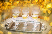 Flutes of champagne in holiday setting,Closeup.  — Stock Photo