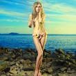 Gorgeous blonde in flower bikini at the sea — Photo #14288159