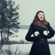 Woman with snow-balls — Stock Photo