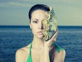 Beautiful lady with large sea shell — Stock Photo