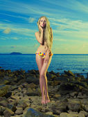 Gorgeous blonde in flower bikini at the sea — Stock Photo