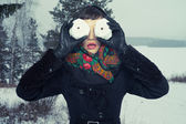 Humorous portrait of woman with snow-balls — Stock Photo