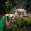Stock Photo: Beautiful lady in coniferous forest