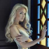Princess at window — Stockfoto