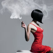 Elegant lady with cigarette — Stock Photo