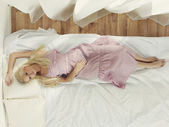 Beautiful woman in bedroom — Stock Photo