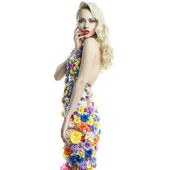 Gorgeous lady in dress of flowers — Stock Photo