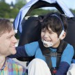 Father enjoying beach with disabled son — Stock Photo