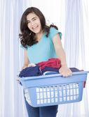Happy teen girl doing the laundry — Stock Photo