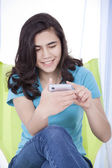 Teen girl texting on a cell phone — Stock Photo