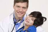 Doctor holding little patient in arms — Stock Photo
