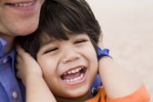 Father and son laughing together — Stock Photo