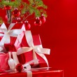 Elegant red gifts under tree — Stock Photo