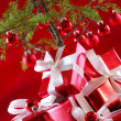 Elegant red gifts under tree — Foto de stock #14037673