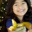 Stock Photo: Little girl holding up cash