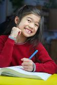 Child doing her homework — Stock Photo