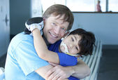 Disabled boy giving father a big hug — Stock Photo