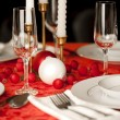 Red and white Christmas table setting — Stock Photo