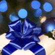 Stock Photo: White gift with blue ribbons