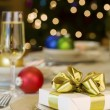 Gold ribbon gift on table — Stock Photo