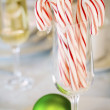 Candy canes and Christmas ornaments — Stock Photo