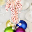 Candy canes and Christmas ornaments — Stock Photo #14948435